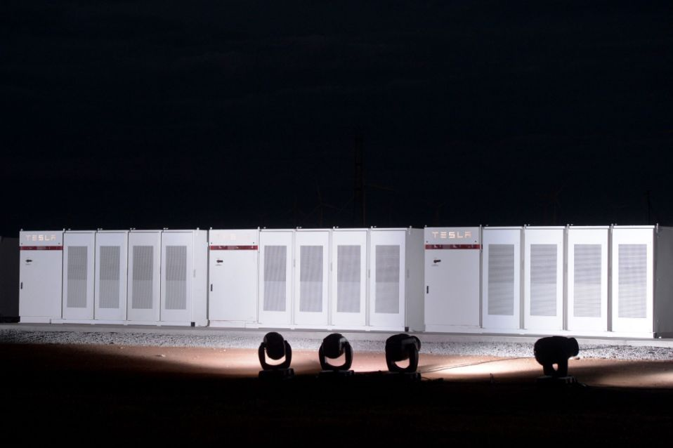 Tesla's giant battery project in South Australia is adjacent to a wind farm, allowing surplus electricity generated on gusty nights to be held for daytime demand. Photographer: Carla Gottgens/Bloomberg